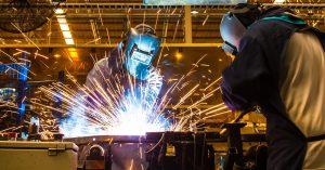 Engineer Welding in Metal Factory